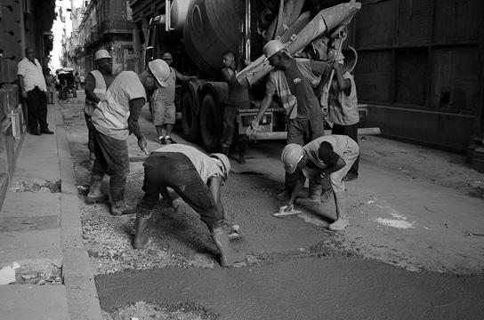 business-in-Cuba-workers-repairing-street